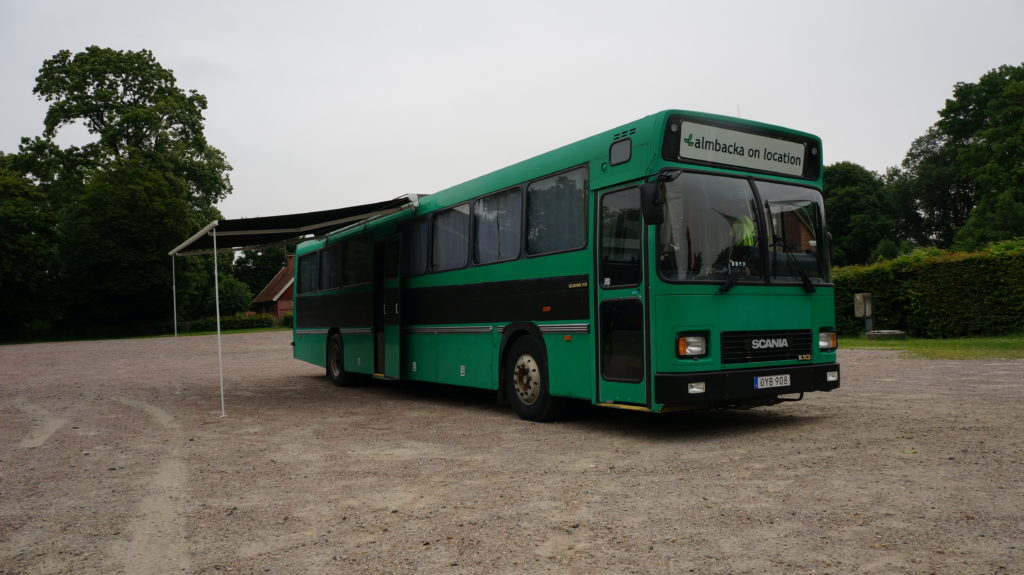 The location bus parked on gravel